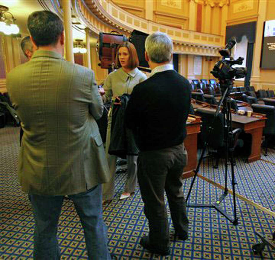 Stacey Johnson, center, press secretary for Virginia Gov. Bob McDonnell, talks with members of the crew that will broadcast the Republican response by McDonnell to President Obama's State of the Union speech Wednesday, as they rehearse Tuesday on the floor of the House of Delegates at the State Capitol in Richmond, Va.  Bob Brown/Richmond Times-Dispatch / RICHMOND TIMES-DISPATCH