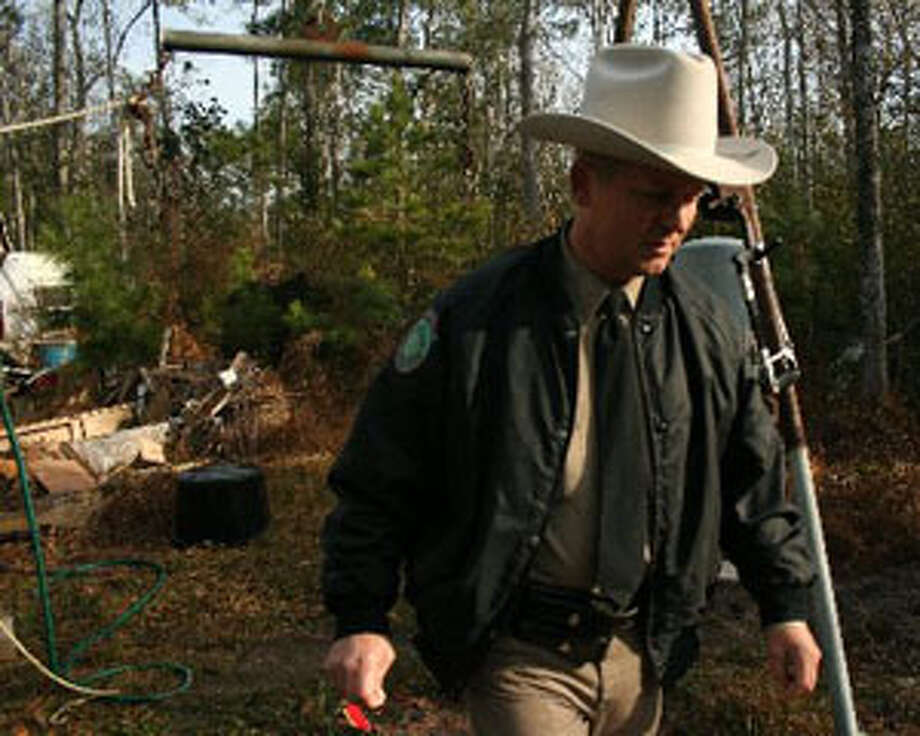 Mike Boone has been a TPWD game warden for more than 17 years. He works in Hardin County. Teresa Mioli/The Enterprise