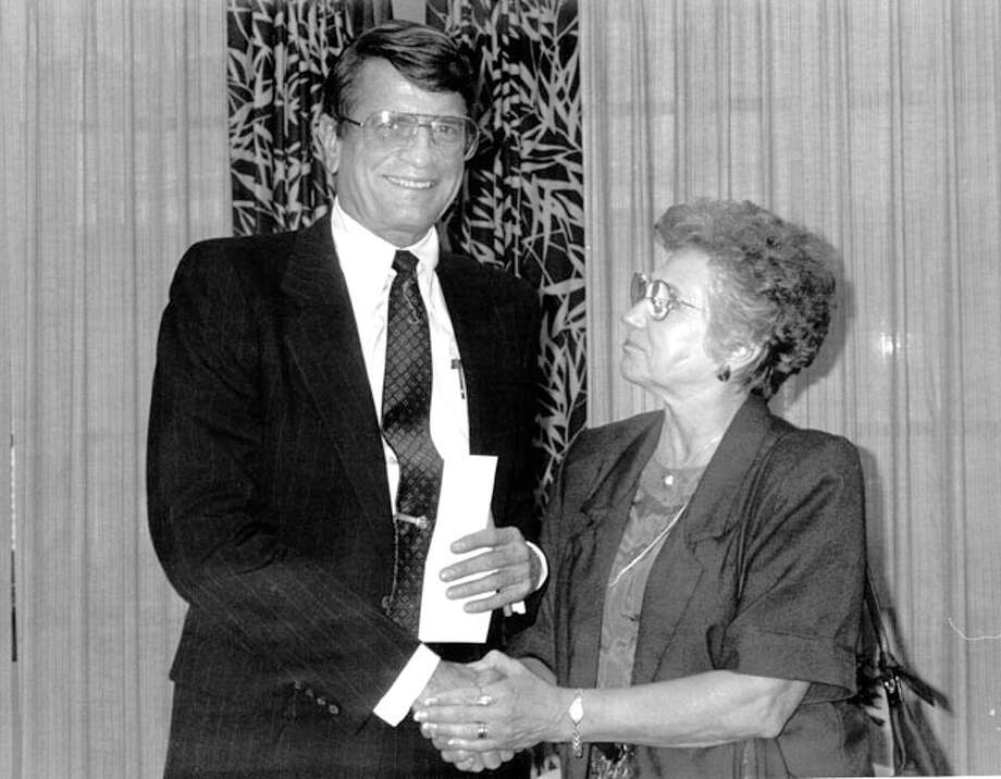 U.S. Rep. Charles Wilson shakes hands with an unidentified woman in August 1992.