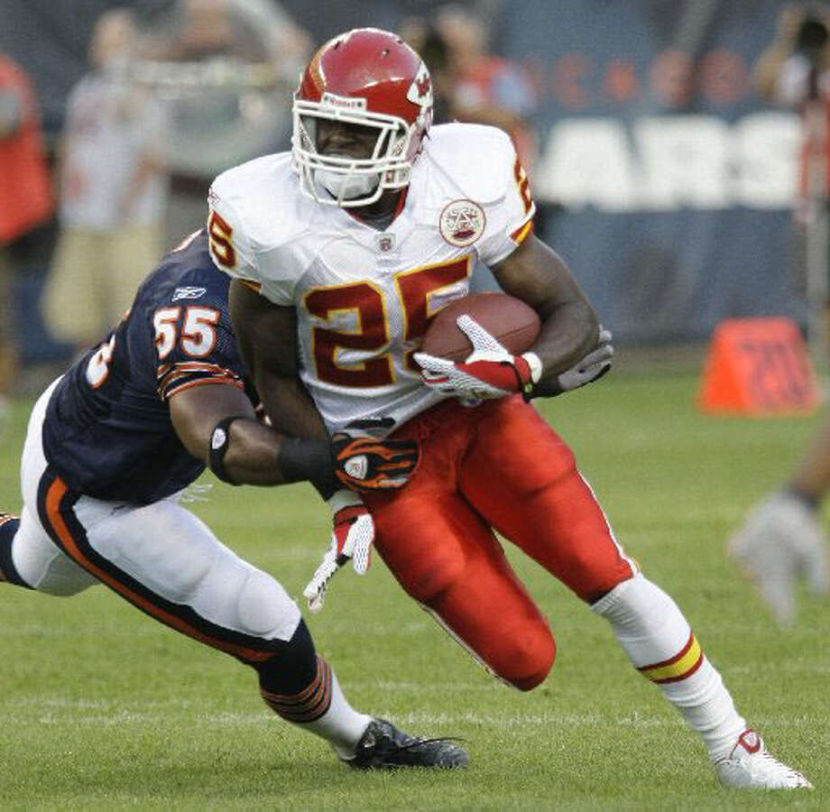 Kansas City Chiefs running back Jamaal Charles,  No. 25, a former Memorial High School and University of Texas standout, carries the ball past Chicago Bears linebacker Lance Briggs during the first half of their preseason NFL football game at Soldier Field in Chicago in the August 2008 game. Associated Press file photo