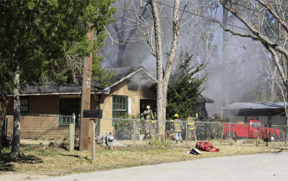 An out of control burn pile set an abandoned house ablaze in Kountze Monday afternoon. Photo courtesy Chris Corbello