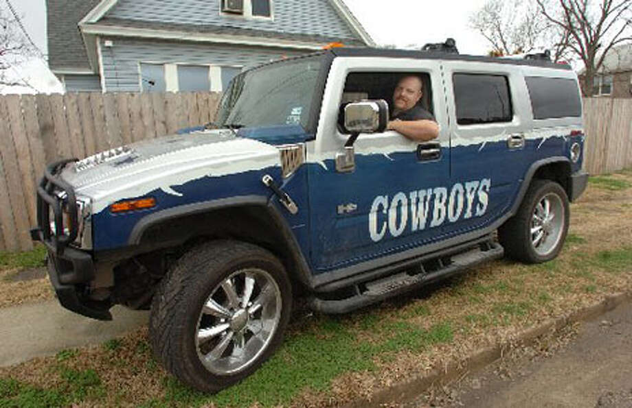 Dallas Cowboy fan Billy Truax keeps his 2002 H-2 Hummer parked in front of his house where it's visible to drivers entering downtown Beaumont from Interstate 10. Pete Churton/The Enterprise