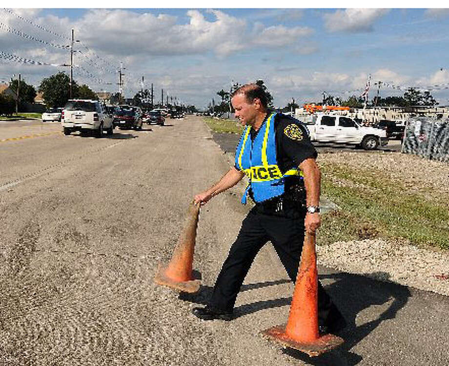 A BISD police officer sets up traffic cones at Regina-Howell Elementary in October. Enterprise file photo