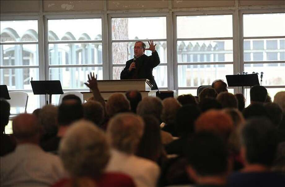 "The Rev. Mark Wilding delivered a sermon Sunday entitled, ""Church on Fire"" during South Point's first service since last week's fire destroyed a section of the facility. Guiseppe Barranco/The Enterprise"