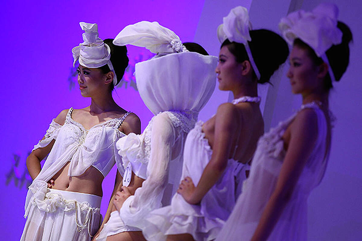 BEIJING - OCTOBER 28: Models walk the runway during Ordifen Cup China Lingerie Design Contest 2010 at China Fashion Week Spring/Summer 2011 on October 28, 2010 in Beijing, China. (Photo by Feng Li/Getty Images)