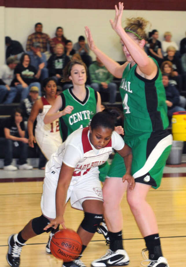 Jasper?s Kim Lewis dribbles the ball around  Central's big center Amber Carver. Central defeated Jasper 56-51.