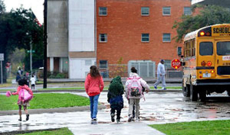 Students at Port Arthur's DeQueen Elementary School make their way home after school on Monday.  Guiseppe Barranco/The Enterprise