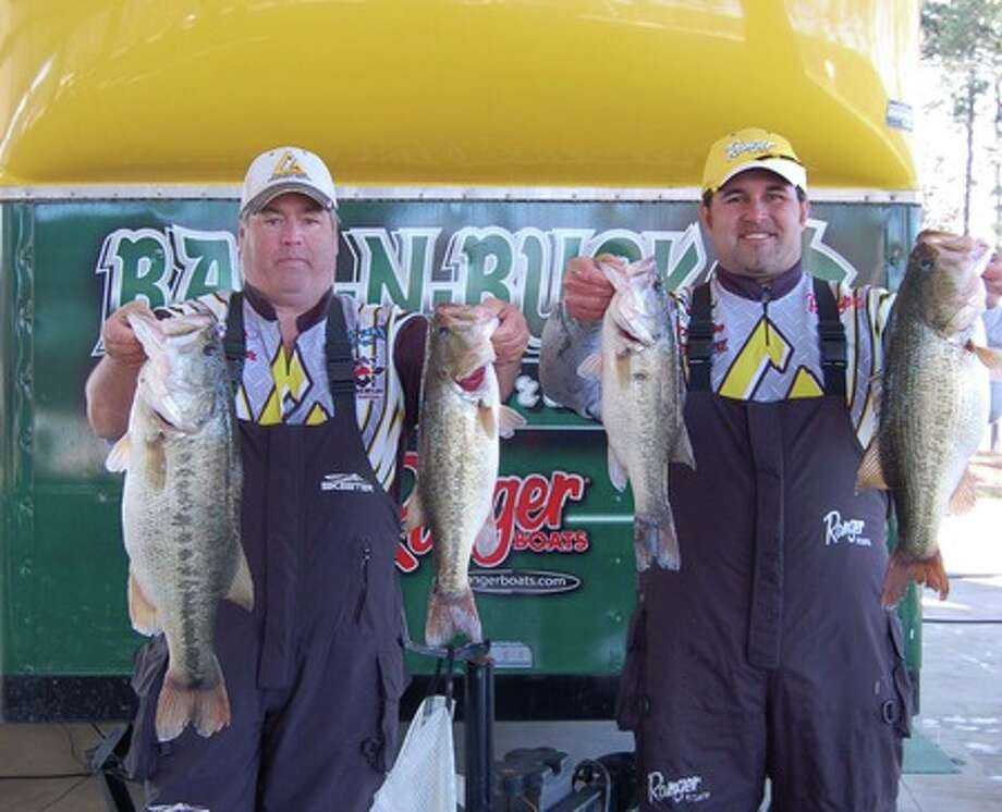 Rusty Clark and Cory Rambo hold up their entire four fish creel weighing 21.49 lbs. winning 1st place by ounces and over $15,000