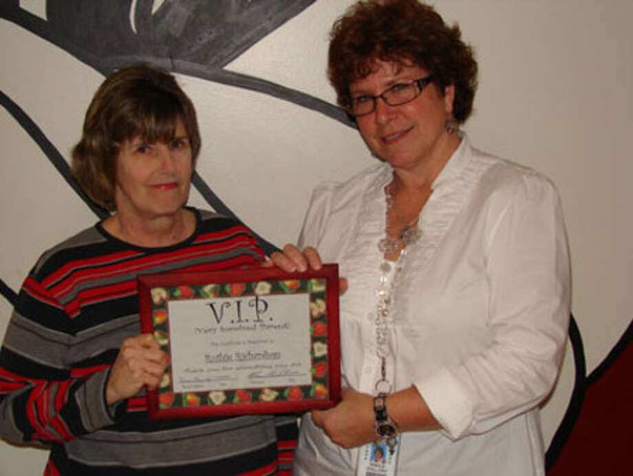 Sheila Guillory presents Ruthie Richardson with the JJHS VIP award for the month of January.