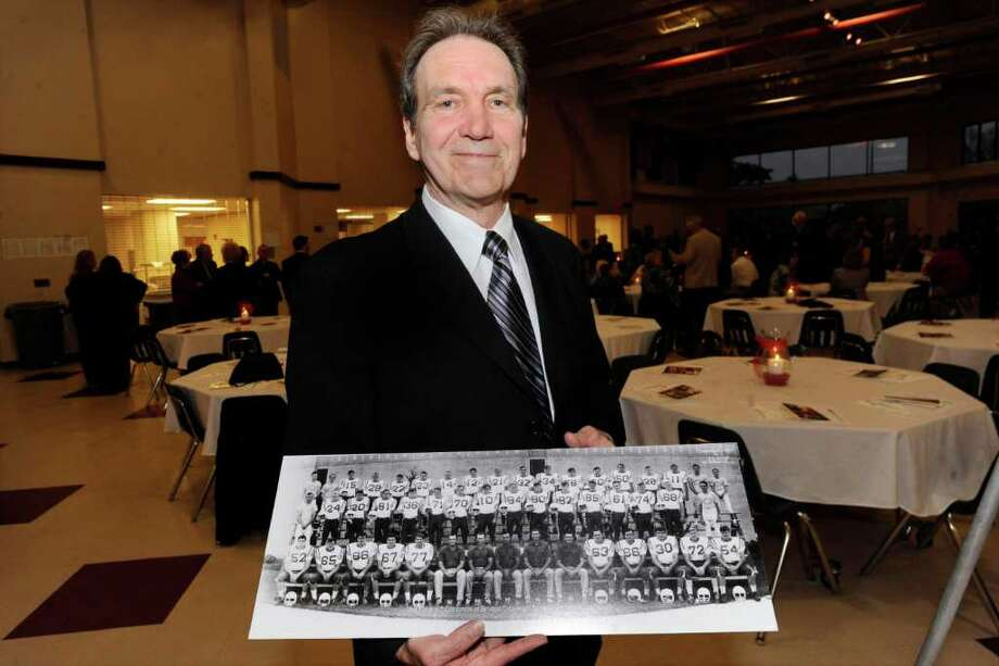 Bridge City Citizen of the Year Steve Worster holds a panoramic photo of the 1967 Cardinals of Bridge City football team. Valentino Mauricio/The Enterprise / Beaumont