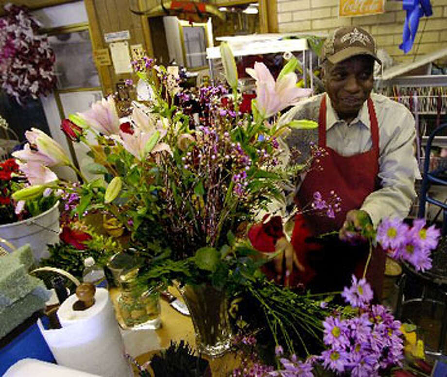 Despite the fact that Valentines Day is on a Sunday this year, florists like Walter McCloney are doing a very brisk business. Orders come in daily for rose arrangements, gift baskets, balloons, etc. McCloney started in the business in 1958, and by 1964, owned his own floral shop. Dave Ryan/The Enterprise