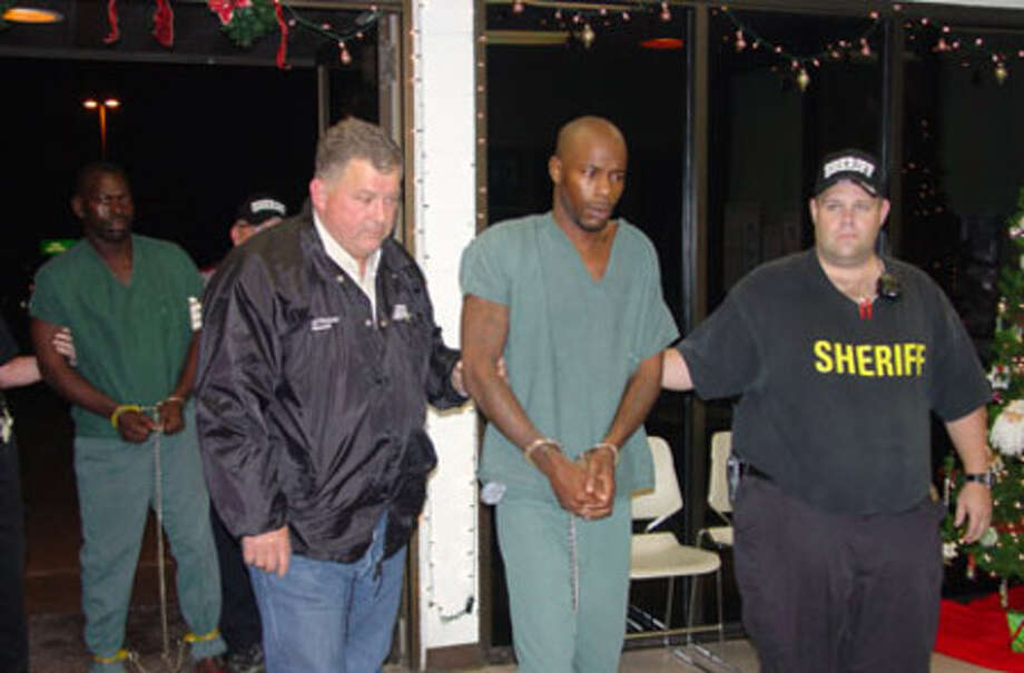 Jasper County Sheriff Mitchel Newman leads a suspect into the Jasper County Jail on Dec. 15.