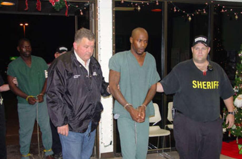 Jasper County Sheriff Mitchel Newman leads a suspect into the Jasper County Jail on Dec. 15.