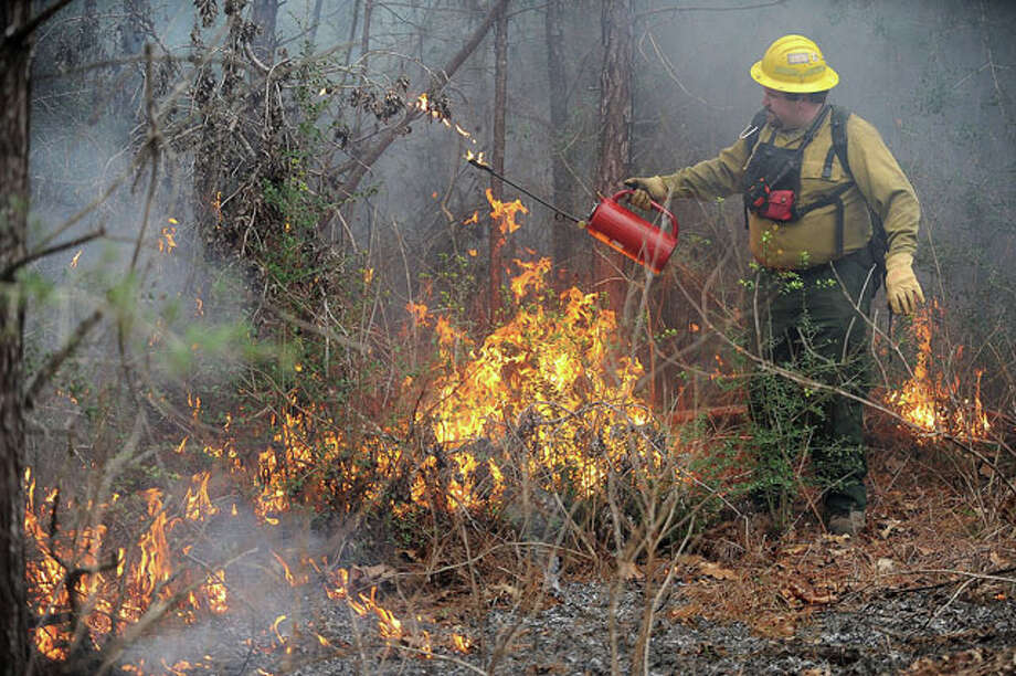 Allen Moffet assists in a controlled burn Monday the Urland Campgrounds. The prescribed fire will consume hazardous material considered to be fuel for wildfires. Guiseppe Barranco/The Enterprise