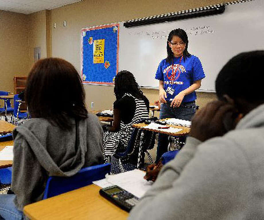 West Brook High School math teacher Tiffany Nguyen reviews work with a class. New revisions in school testing will opt for more specific methods of testing for high school students beginning in the 2011-2012 school year. Guiseppe Barranco/The Enterprise