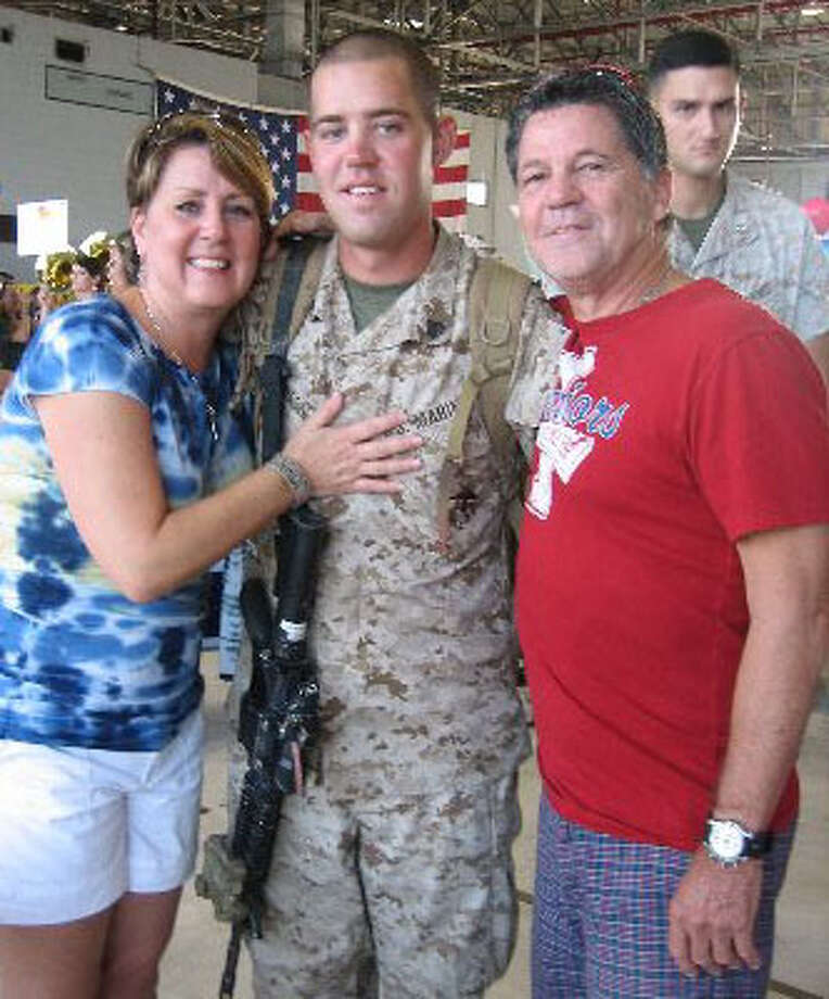 U.S. Marine Sgt. Colby Johnson, here with his parents Trudy and James Johnson, said the Sept. 11, 2001 events were a major factor in his decision to join the Marines. Provided photo.