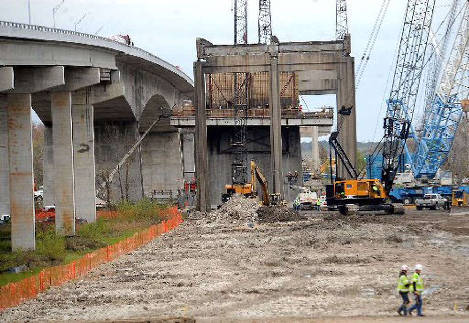 The process of dismantling the old Trinity River Bridge continues Tuesday near Anahauc. Tammy McKinley/ The Enterprise