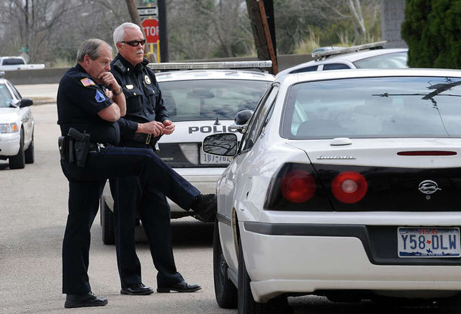 Beaumont Police officers assess the situation while an unknown number of men are holed up in a home near Concord Road. Officers responded to a report of domestic abuse and upon their arrival a man locked himself inside the home and refused to come out. The report of possible weapons in the home brought more officers and a K-9 unit. Guiseppe Barranco/The Enterprise