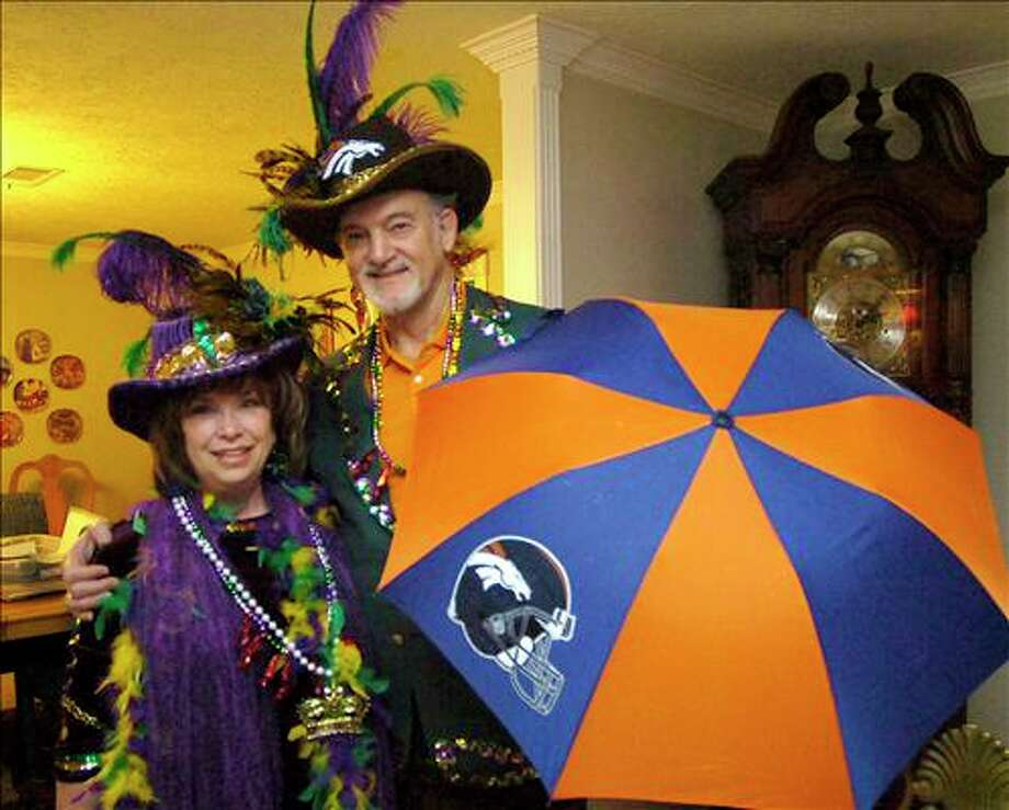 "Austin ""Goose"" Gonsoulin, right, and his wife Nickie, will be side by side Saturday as Gonsoulin takes his seat as the Grand Marshall in Port Arthur's Mystic Krewe of Aurora parade. Gonsoulin played for the Denver Broncos in the 1960s. Dave Ryan/The Enterprise"