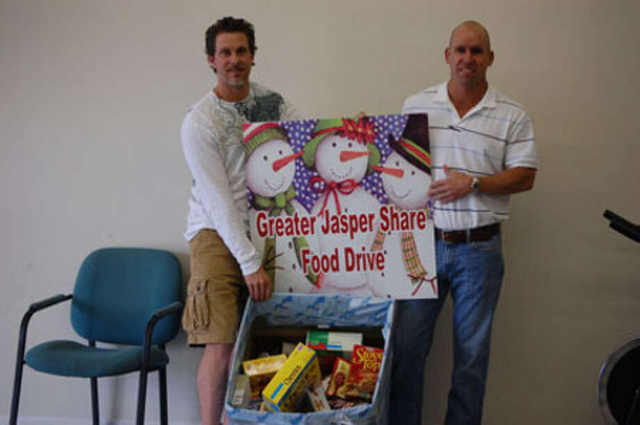 Carl Morgan and Cory Latham, owners of Bottoms Up Tanning and Fitness Center, show-off their donated food items that they will be giving to Jasper Share.