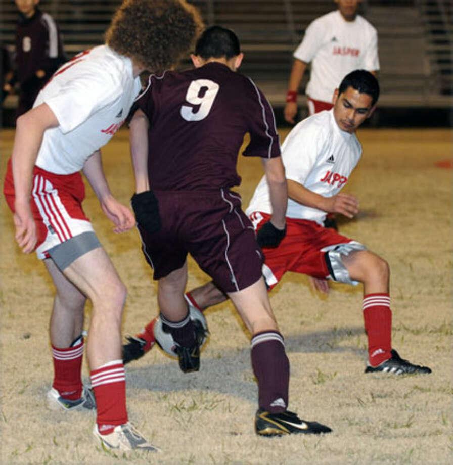 Jasper?s Parker Stover and Juan Desantiago battle a Hudson defender for a ball during last week?s contest.