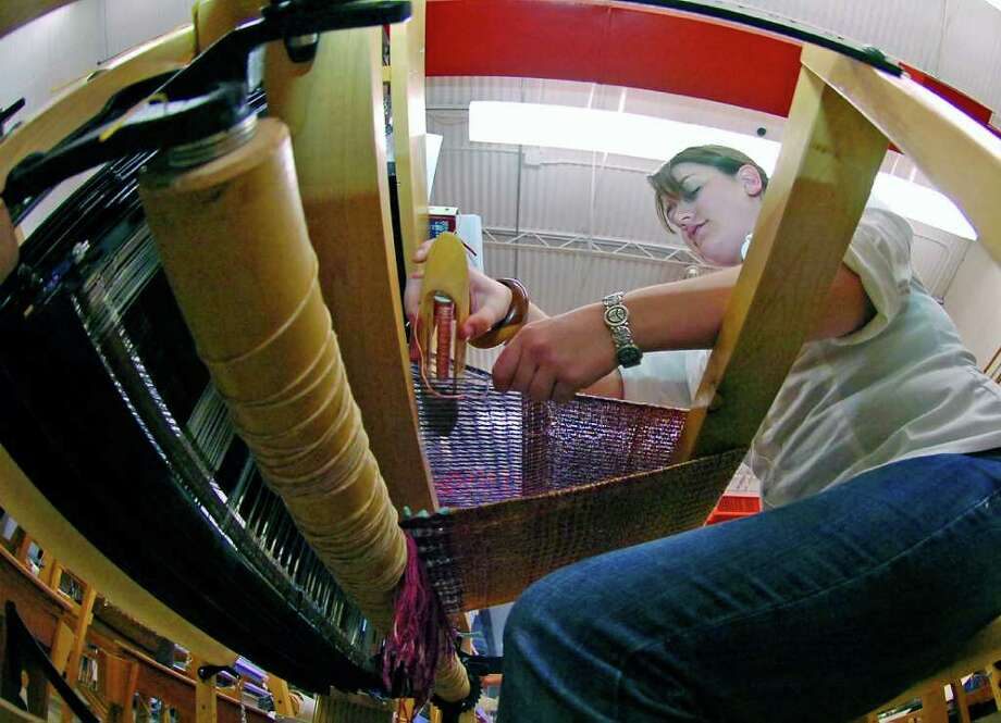 Maegan Peltier works on her sampler project on a loom in the Art Department at Lamar University.  The University offers a niche program that allows students to focus on the art of weaving and surface design.  This degree program is applicable in both the clothing and textiles industries as well as for art purposes. Dave Ryan/The Enterprise / Beaumont