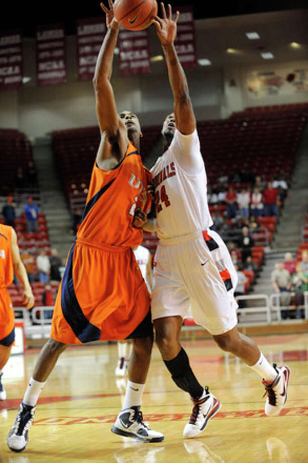 Lamar forward Justin Nabors, right, battles for a rebound against UT-SA defender Terry Fields during their conference game at the Montagne Center. Saturday, February 27, 2010. Valentino Mauricio/The Enterprise