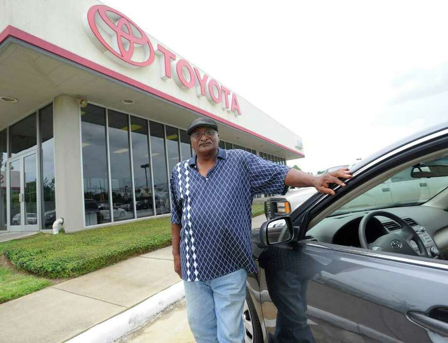 Beaumont resident Louis Bowman stands next to the new 2010 Toyota Camry he and his wife, Daisy, purchased from Kinsel Toyota with the aid of the federal Cash for Clunkers program. Valentino Mauricio/The Enterprise / Beaumont