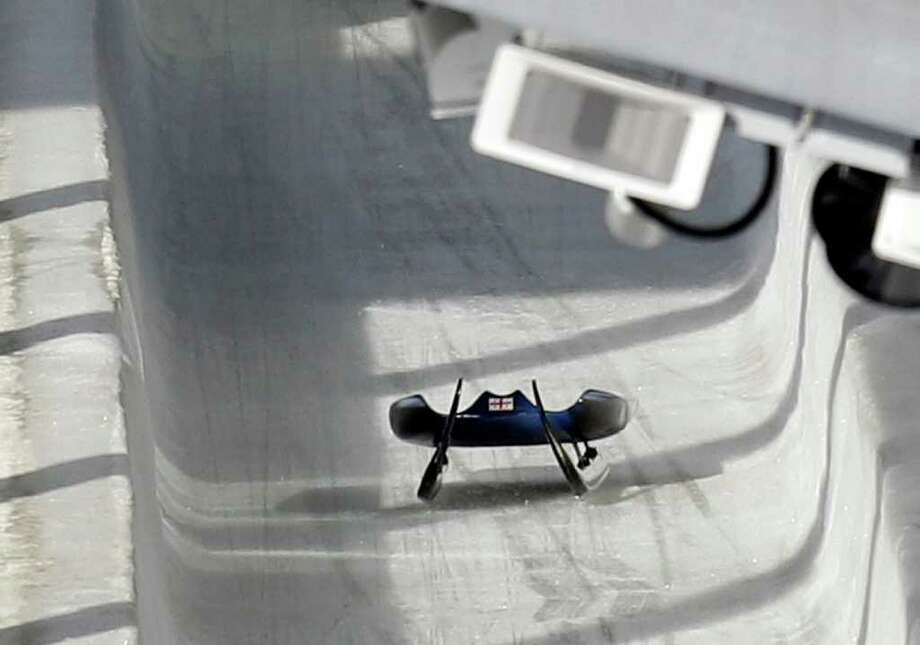 The sled belonging to Nodar Kumaritashvili of Georgia is seen just after he crashed in a training run for the men's singles luge at the Vancouver 2010 Olympics Friday in Whistler, British Columbia, Friday. Kumaritashvili, 21, died of his injuries. Michael Sohn/The Associated Press / AP