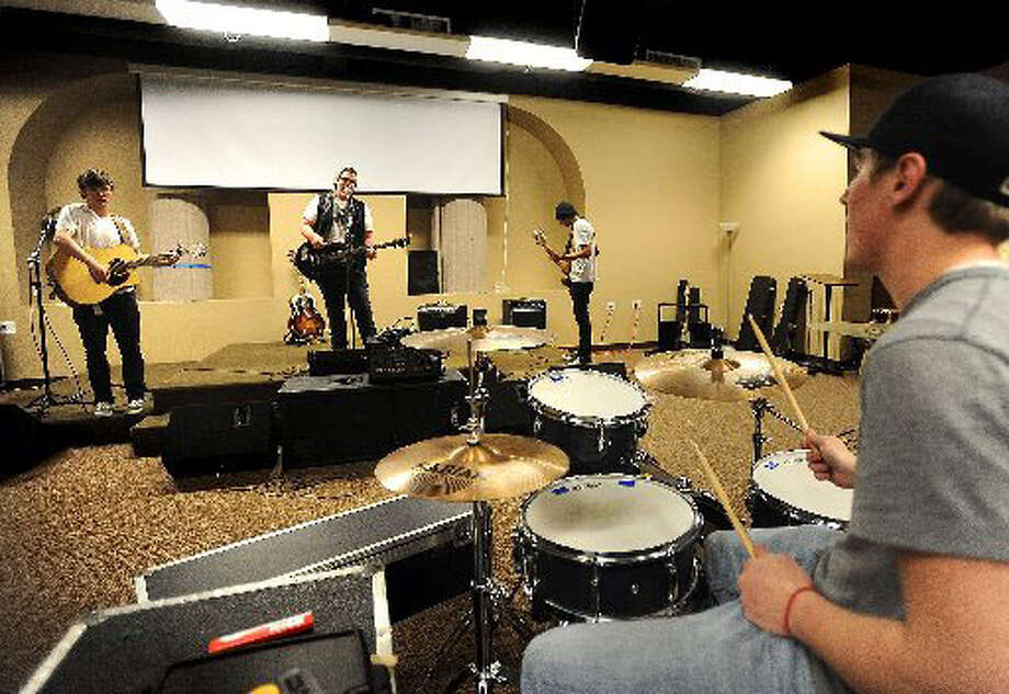 "From left, Jeremy Schexnider, Roddy Hall, Jeromie Grammer and Samuel Roedahl practice Monday at Golden Triangle Church on the Rock. The band will soon release its first EP ""Letting Go."" Guiseppe Barranco/The Enterprise"