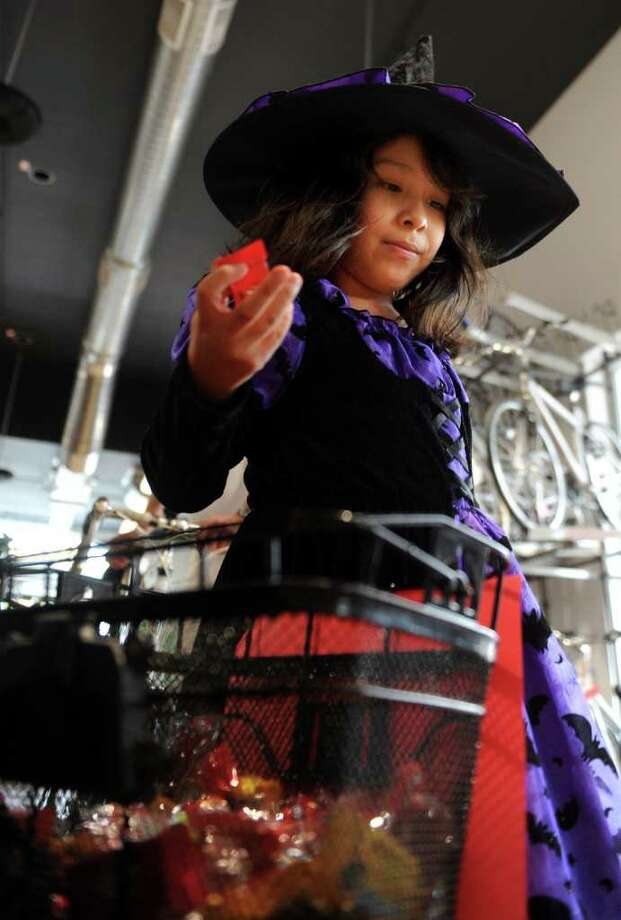 Kelly Utreras, 8, gets her choice of candy at Trek Bicycle Store during the Trick or Treat on Safety Street event in Fairfield on Friday, October 29, 2010. Photo: Lindsay Niegelberg / Connecticut Post