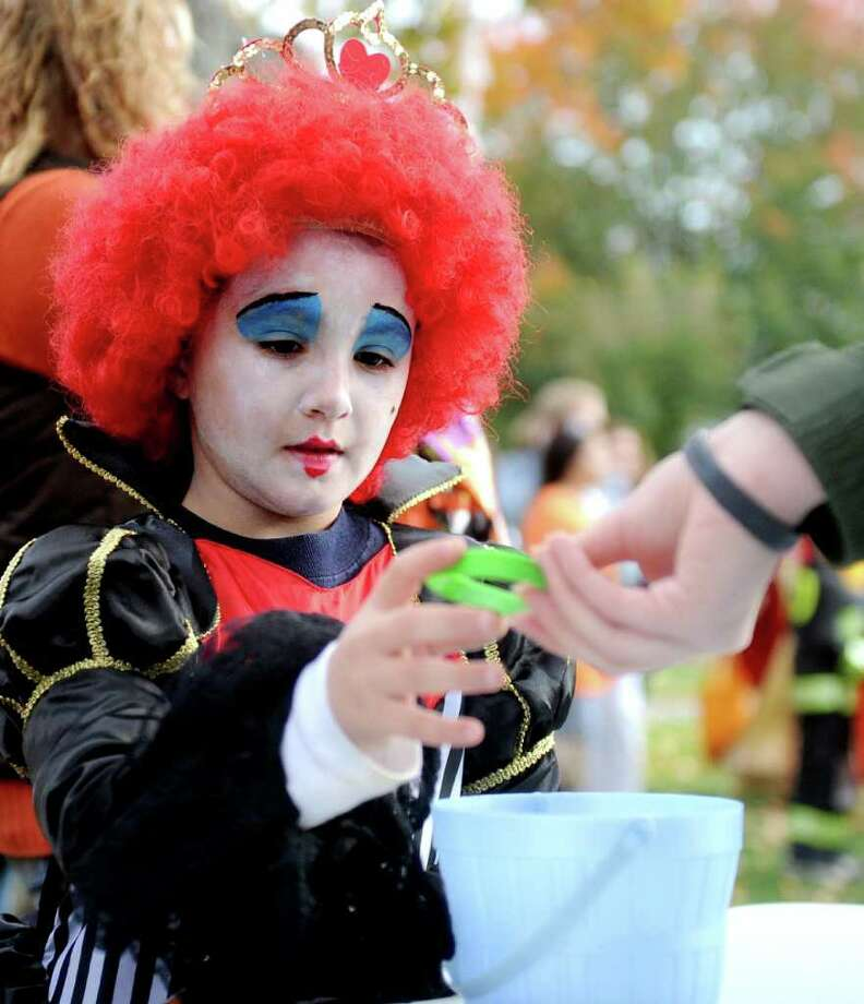 Alexis Torri, 7, gets candy during the Trick or Treat on Safety Street event in Fairfield on Friday, October 29, 2010. Photo: Lindsay Niegelberg / Connecticut Post