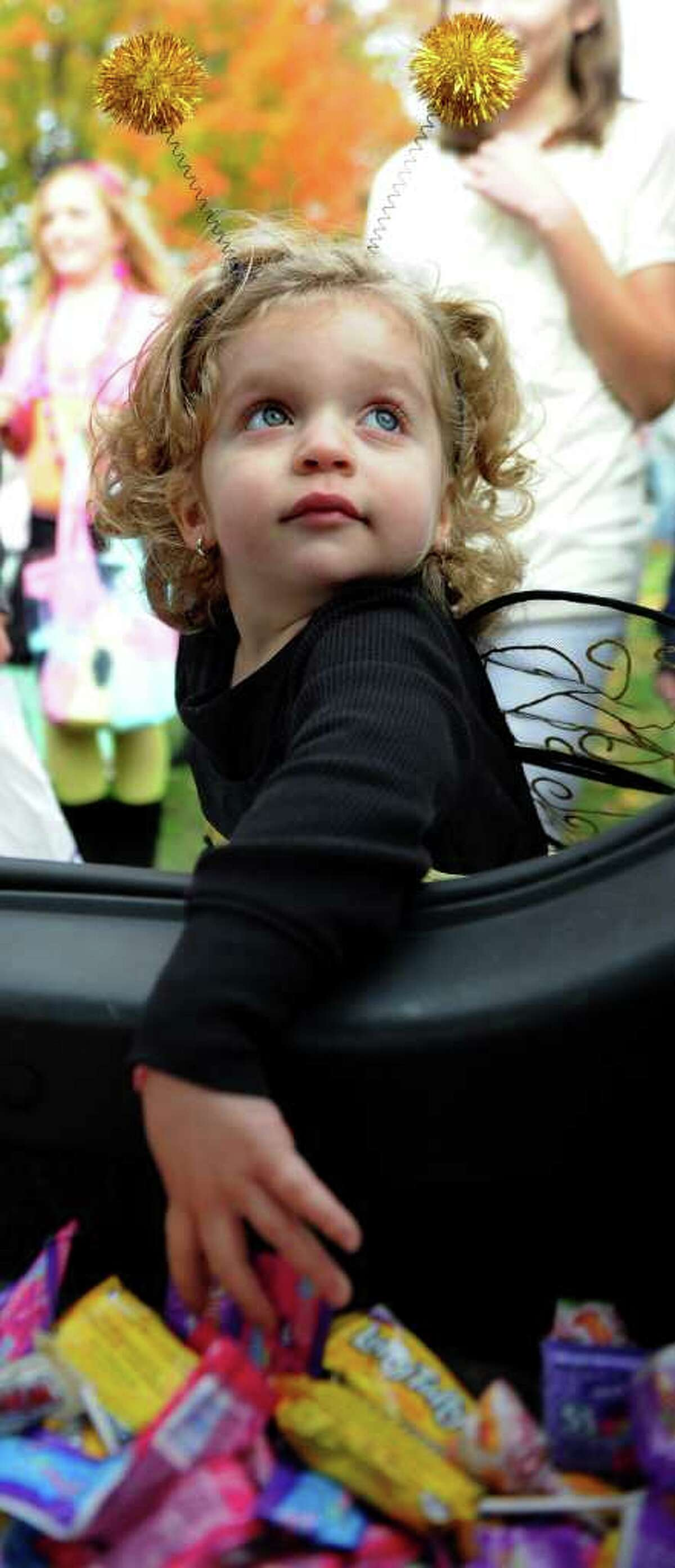 Bella Boccuzzi, 2, gets candy during the Trick or Treat on Safety Street event in Fairfield on Friday, October 29, 2010.
