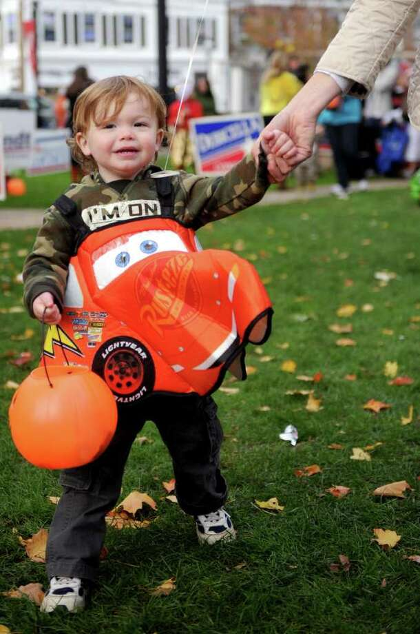 Barrett Mullahy, 2, walks with his mother during the Trick or Treat on Safety Street event in Fairfield on Friday, October 29, 2010. Photo: Lindsay Niegelberg / Connecticut Post