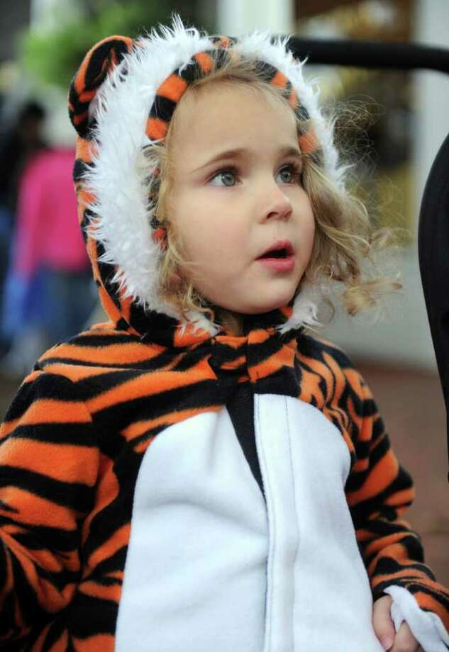 Elisabeth Sweer, 3, looks at other people in costume during the Trick or Treat on Safety Street event in Fairfield on Friday, October 29, 2010. Photo: Lindsay Niegelberg / Connecticut Post