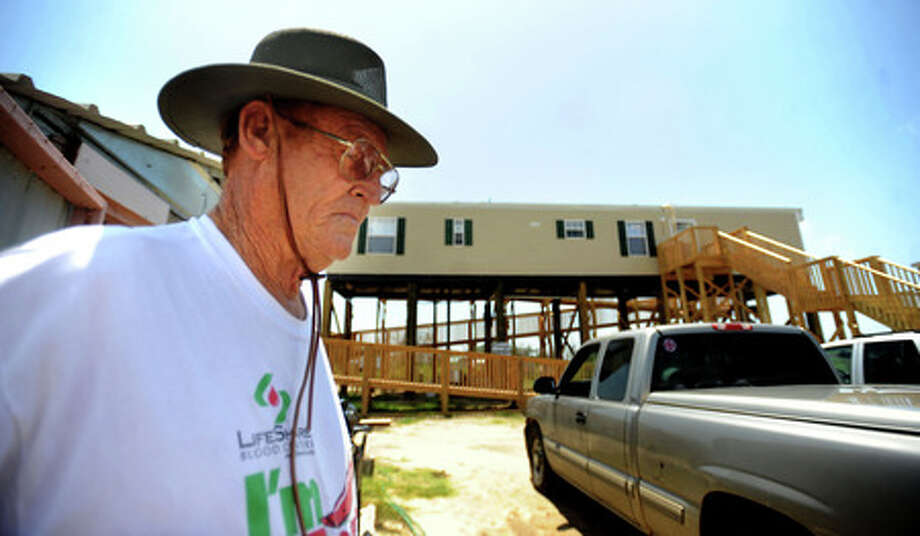 Marshall Jackson talks about the rebuilding process after Hurricane Rita and Ike destroyed his homes in Sabine Pass, Wednesday. Tammy McKinley, The Enterprise