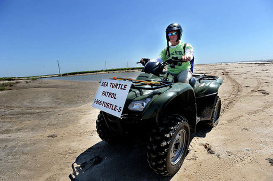 Andy Landry slowly rides his four wheeler toward a trailer after getting a flat tire while searching for sea turtles on Bolivar Peninsula Tuesday. Contrary to recent years, turtle population in the area has reduced largely to Hurricane Ike's reshaping of the beach. Guiseppe Barranco/The Enterprise
