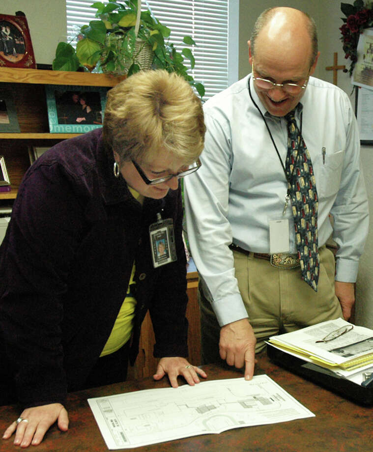 Diane Daniels,52, left, superintendent for Kountze Independent School District, goes over Kountze High School and the Kountze Penland Middle School building plans with assistant superintendent Jon Ellis, 49, at administration offices Tuesday. Lluvia Rueda/The Enterprise