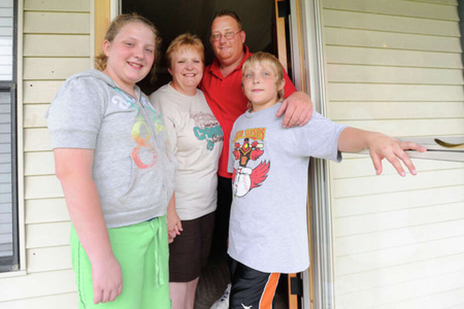 Million dollar Lotto ticket winners, the Moore family, pictured at home in Bridge City, from left, Bailee, Lisa, Dennis and Trace.  Valentino Mauricio/The Enterprise