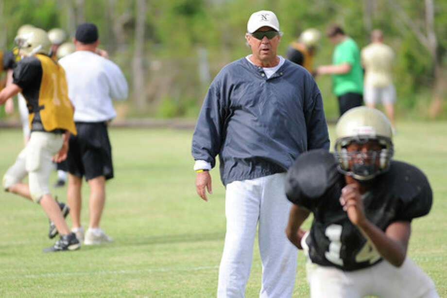 Nederland head football coach Larry Neumann kept the intensity up during drills on the first day of spring practice.  Valentino Mauricio/The Enterprise