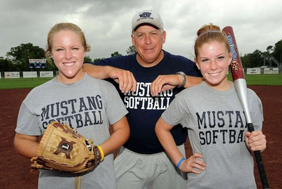 Head coach Randy Ragsdale poses with his daughters Sarah Ragsdale and Rebekah Ragsdale after practice at West Orange-Stark on Monday. Guiseppe Barranco/The Enterprise