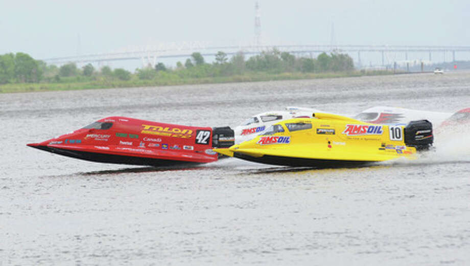 Terry Rinker (10) with the AMSOIL team was the the winner in the Champ division with Shaun Torrente (42) of the CANAM team in a close second  during the first day of racing at the Port Neches RiverFest on Saturday,  May 2. 2009.  Valentino Mauricio/The Enterprise