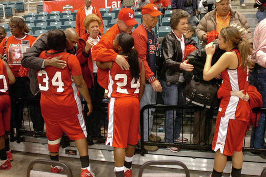 Lady Cards visit the stands to meet family and fans after falling 67-62 to UT Arlington at the Southland Conference Basketball Tournament. Valentino Mauricio/The Enterprise