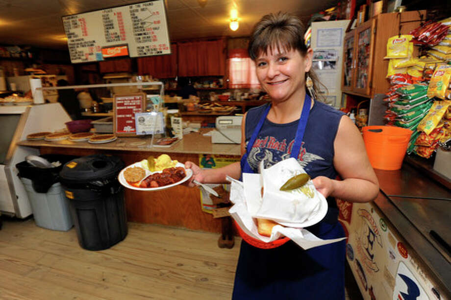 Alma Byars, manager of West Texas Bar-B-Q, has been happily serving customers for over 23 years at her family's restaurant in Silsbee. Byars said that one of the joys of working there is getting to work with her best friend every day, her mom, Nita Nolen. Valentino Mauricio/The Enterprise