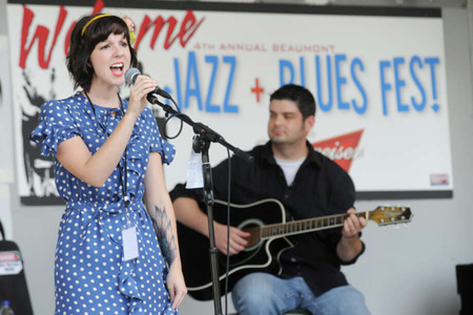 Ashlynn Ivy of Port Neches-Groves performed with Greg Williams on guitar and her band at the Jazz and Blues Fest on Saturday in downtown Beaumont. Valentino Mauricio/The Enterprise