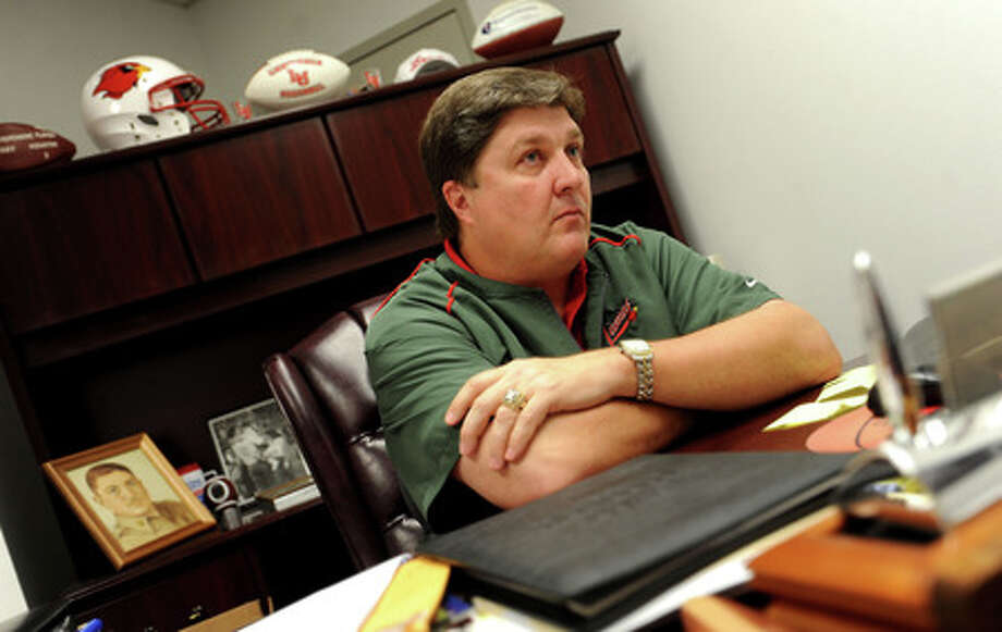 Coach Ray Woodard talks about the progress in setting up the new Lamar University football program at the Montagne Center in Beaumont, Tuesday. Tammy McKinley, The Enterprise