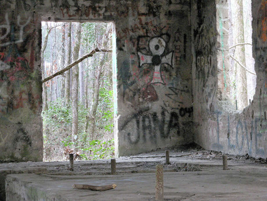 Graffiti covers the walls of one of four remaining buildings at Aldridge Sawmill ghost town in northwestern Jasper County in the Angelina National Forest. The site is on the National Register of Historic Places. Kyle Peveto/The Enterprise