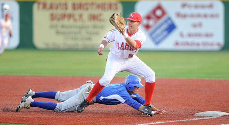 Cardinal first baseman Steven Tucker tries to keep A&M-Corpus Christi's Jonathan Reyes on the bag during the second inning.    Valentino Mauricio/The Enterprise