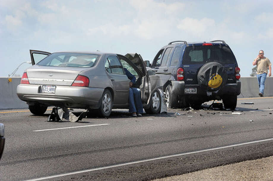 Two cars collided Wednesday during a traffic jam that stemmed from two vehicular accidents involving pedestrians on US 69 near Spurlock Road. One person was killed in the pedestrian accident.   Guiseppe Barranco/The Enterprise
