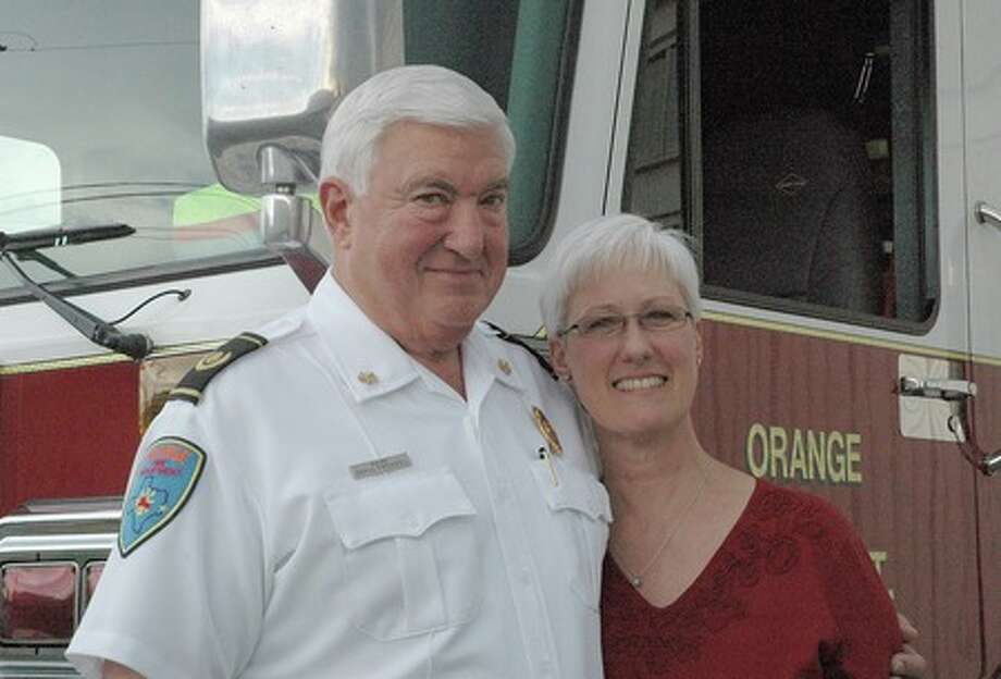 "Orange Fire Chief David Frenzel marked his 40th year with the fire department this past week. Mayor Brown Claybar said the city gets ""two for one"" with Frenzel and his wife, Hildy, who goes to fires to serve cold drinks and hot coffee to firefighters. The two, who have been married 31 years, met while she was working at the fire station. Margaret Toal/The Enterprise"